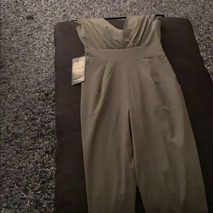 Bebe Jumpsuit in army green New with tags